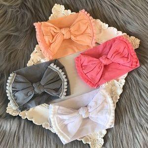 Brand New Set of 4 Nylon Pom Bow Baby Headbands
